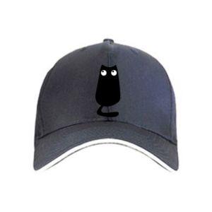 Cap Black cat with big eyes is sitting