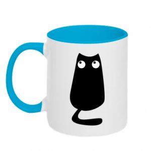 Two-toned mug Black cat with big eyes is sitting