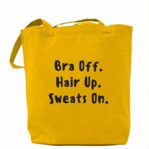 Torba Bra off. Hair up. Sweats on.