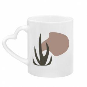 Kubek z uchwytem w kształcie serca Grass on blur background