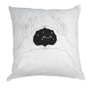 Poduszka Kosmos w rękach
