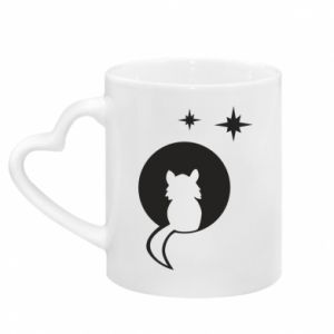 Mug with heart shaped handle The cat sits on the moon