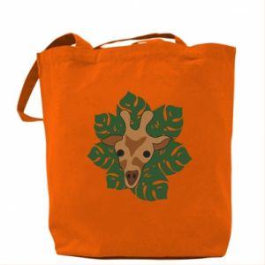 Bag Giraffe in monstera leaves